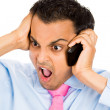 Closeup portrait of angry man shouting while on phone — Stock Photo