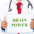 Stock Photo: Closeup portrait of health professional holding up sign that says brain power