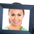 Happy young girl inside of picture frame — Stock Photo