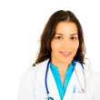 Confident female doctor folding arms against white background — Foto de Stock