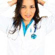 Female doctor pulling hair out in frustration — Stock Photo
