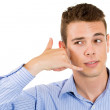 Closeup portrait of man making call me gesture with hand shaped like phone — Stock Photo #29617827