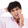 Closeup portrait of handsome man with tooth ache and headache touching face and head — Stock Photo