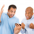 Two guys surprised by what they see on their cell phone — Stock Photo