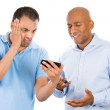 Two guys angry at something on their cell phone — Stock Photo