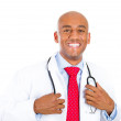 Handsome doctor holding stethoscope — Stock Photo