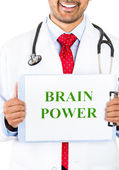 Closeup portrait of a health professional holding up a sign that says brain power — Стоковое фото