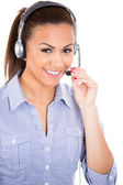 A portrait of a beautiful female customer service representative or operator or help desk support staff wearing a head set — Stock Photo