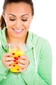 Closeup portrait of female holding glass of orange juice and looking inside — Stock Photo