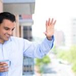 Handsome man waving from balcony — Stock Photo #29652941