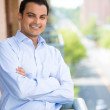 Closeup portrait of handsome man with arms folded enjoying life on outside balcony — Stock Photo #29653031