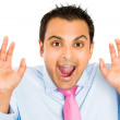 Closeup portrait of funny guy in blue shirt and pink tie who is surprised and shocked — Stock Photo