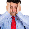 Closeup portrait of handsome businessman with hands on head with headache, stressed, frustrated, about to quit — Stock Photo