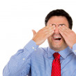 Closeup portrait of businessman covering his eyes with his hands not wanting to see something bad — Stock Photo