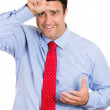 Closeup portrait of handsome male guy showing a loser sign on his forehead and mocking you — Stock Photo