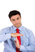 Closeup portrait of handsome man making time out sign with hands — Stock Photo