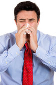 Closeup portrait of male with cold and blowing nose in kleenex — Stock Photo