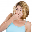 Close-up portrait of a young attractive woman who covers her nose, looks away, something stinks — Stock Photo #29693449