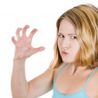 A close-up portrait of a stressed angry mad woman threatening you with her claws , nails — Stock Photo