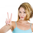 Cute young woman showing the peace or victory hand sign — Stock Photo