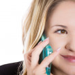 Close-up portrait of blonde woman talking on the phone — Stock Photo