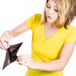 A picture of a cute girl in a blank yellow T-shirt standing against white background with an empty wallet — Stock Photo