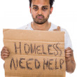 A portrait of a homeless hungry man begging for help and food holding a sign — Stock Photo