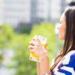 A portrait of a beautiful young female relaxing on a balcony on a sunny summer day — Stock Photo
