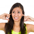 Young woman with his hands covering his ears not to hear noise. — Stock Photo #29694885