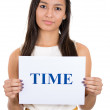 A portrait of a beautiful woman holding a sign which says time — Stock Photo
