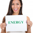 A portrait of a beautiful smiling, happy businesswoman holding a sign which says energy — Stock Photo
