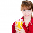 Close-up portrait of a young attractive happy woman with glass of orange juice — Stock Photo #29695603
