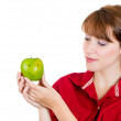 Close-up portrait of a beautiful young woman holding a green apple — Stock Photo