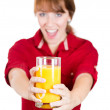 Close-up portrait of a young attractive happy woman with glass of orange juice — Stock Photo #29695613