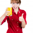 Close-up portrait of a young attractive happy woman with glass of orange juice — Stock Photo