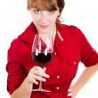Close-up portrait of a young beautiful woman with a glass of red wine — Stock Photo