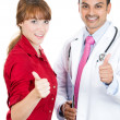 Closeup portrait of health care professional or doctor or nurse showing thumbs up with patient — Stock Photo