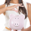 Piggybank money concept. Savings and financial concept. Closeup, cropped portrait  of a young smiling business woman hand putting money in piggy bank savings. — Stock Photo