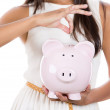 Piggybank money concept. Savings and financial concept closeup, cropped picture of business woman, hand putting money in piggy bank savings, isolated on a white background. — Stock Photo