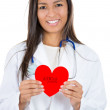 Close-up portrait of smiling, friendly female doctor holding heart, isolated on white background. Cardiology care. — Foto Stock #29695885