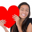 Love and valentines day woman holding heart smiling. Adorable beautiful young woman isolated on white background. Beautiful ethnic woman in love. — Stock Photo