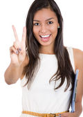 Beautiful woman giving a victory sign — 图库照片