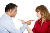 Two people, couple pointing fingers at each other, blaming each other for problem — Foto Stock