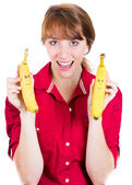 Close-up portrait of a beautiful young woman holding two funny banana — Stock Photo