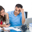 Closeup portrait of attractive couple, man and woman, looking distressed from financial problems and mounting bills — Stock Photo