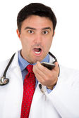 Closeup portrait of enraged health care professional or doctor or nurse or dentist yelling into phone — Stock Photo