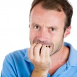 Scared, worried, anxious man biting nails — Stock Photo