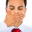 Handsome man covering his mouth — Stock Photo