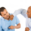 Two guys fighting, one guy punches, other guy falls back — Stock Photo