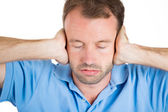 Handsome man covering his ears — Stock Photo